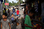 People go about their daily lives in an urban slum in Paranaque City, Metro Manila, The Philippines on 19 January 2013. Photo by Suzanne Lee for Save the Children UK