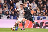 Real Madrid's Lucas Vazquez and Real Sociedad's Kevin Rodriguez during La Liga match between Real Madrid and Real Sociedad at Santiago Bernabeu Stadium in Madrid, Spain. January 29, 2017. (ALTERPHOTOS/BorjaB.Hojas)