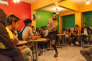 Wissam, a gay Syrian refugee in Istanbul dances at a same-sex Syrian engagement party the My Dubai Cafe in the city, before an audience of other LGBT refugees from Syria and Iraq. Muhammed Wisam Sankari, also a gay Syrian man (wearing a black baseball cap at rear) was recently murdered in Istanbul and reportedly beheaded in a homophobic attack