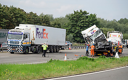 © Licensed to London News Pictures. 26/08/2017. Milton Keynes, UK. A trailer involved in the crash being taken away by another lorry (left) and the lorry and minibus (pictured right, being removed). Police say that several people are dead and four others have been taken to hospital after the accident on the southbound carriageway of the M1 near Milton Keynes in the early hours of this morning. Photo credit: Ben Cawthra/LNP