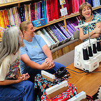 072114  Adron Gardner/Independent<br /> <br /> <br /> Lynn Olinger, left, Jeannie Kamps and Lisa Byker share stories at the Gallup Service Mart in Gallup Monday.