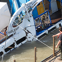 Rescue personnel work on lifting up the passenger boat Hableany (means Mermaid in Hungarian) from the river almost two weeks after it's capsize in an accident on river Danube in downtown Budapest, Hungary on June 11, 2019. ATTILA VOLGYI