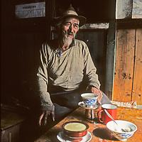 Sherpa elder Kunchok Chombi drinks yak butter tea by a window in a house in Namche Bazaar, the biggest town in Nepal's Khumbu region.