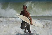 Skimboarder exiting surf, at the '07 Dewey Beach skim boarding championship.