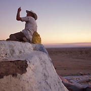 Leonard Knight lives at Slab City, a deserted World War II training ground where concrete slabs that served as foundations are used by squatters, misfits, loners and others who want to remain on the fringe of society. Knight spent 14 years painting a hillside religious tribute seen at the entrance to Slab City.