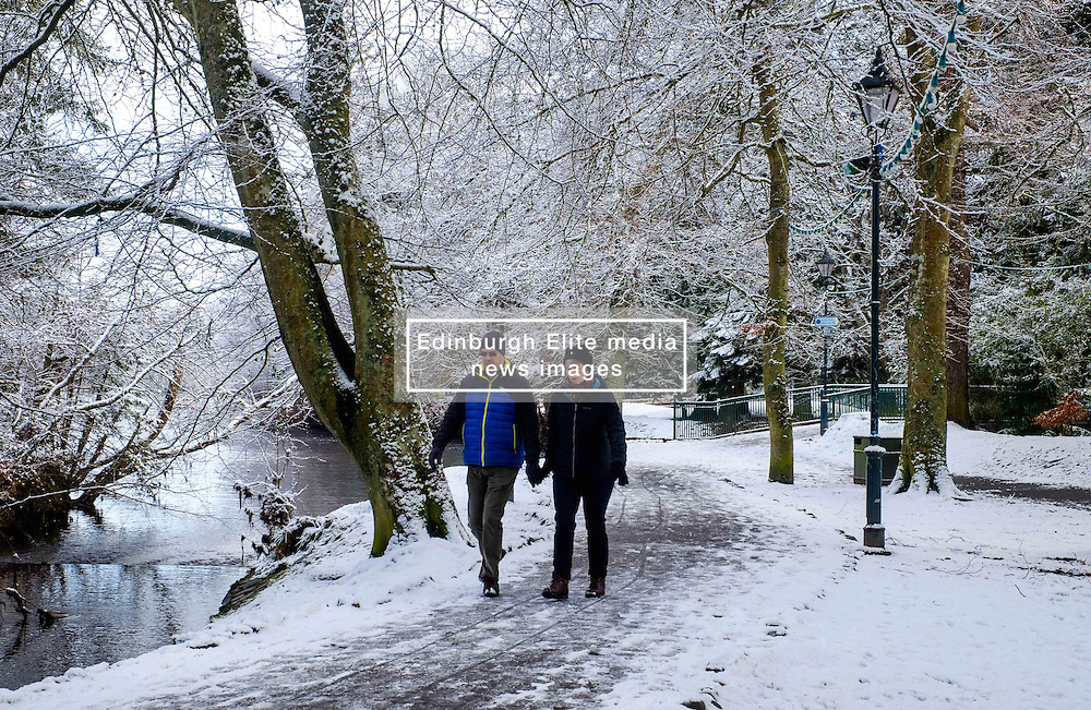 A couple walk hand in hand by the River Ness in Inverness, Scotland on Valentine's Day<br /> <br /> (c) Andrew Wilson | Edinburgh Elite media