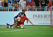 Canada's Matt Mullins drags USA's Perry Baker over the try line to score during the HSBC World Rugby Sevens Series, Singapore, Cup Final match USA -V- Canada  at The National Stadium, Singapore on Sunday, April 16, 2017. (Steve Flynn/Image of Sport)