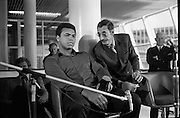 Muhammad Ali In Dublin..1972..11.07.1972..07.11.1972..11th July 1972..Prior to his fight against Al 'Blue' Lewis at Croke Park ,Dublin, former World Heavyweight Champion,Muhammad Ali arrives at Dublin Airport..The fight was part of his build up for for a championship fight against the current World Champion, 'Smokin'  Joe Frazier. Ali had been stripped of the title partly due to his refusal to join the American military during The Vietnam War,which he had opposed...Image of Muhammad Ali and boxing promoter Harold Conrad as they prepare for the press conference. Partially hidden by the microphone stand is British boxer, Joe Bugner.