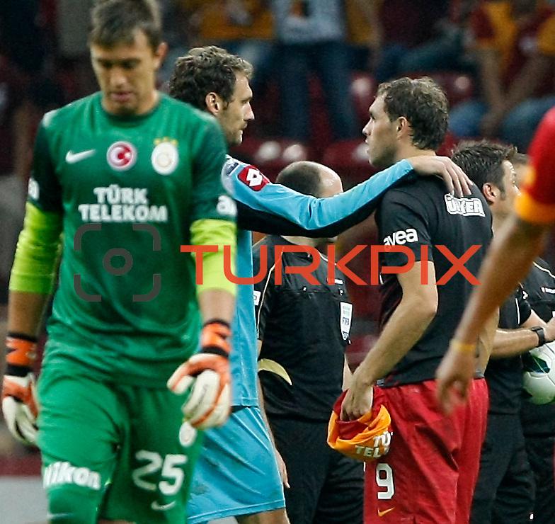 Galatasaray's Johan Elmander (R) and Kasimpasa's goalkeeper Andreas Isaksson during their Turkish Super League soccer match Galatasaray between Kasimpasa at the TT Arena at Seyrantepe in Istanbul Turkey on Monday 20 August 2012. Photo by TURKPIX