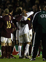 Photo: Chris Ratcliffe.<br /> Arsenal v Real Madrid. UEFA Champions League. 08/03/2006.<br /> David Beckham hugs Thierry Henry at the end of the game