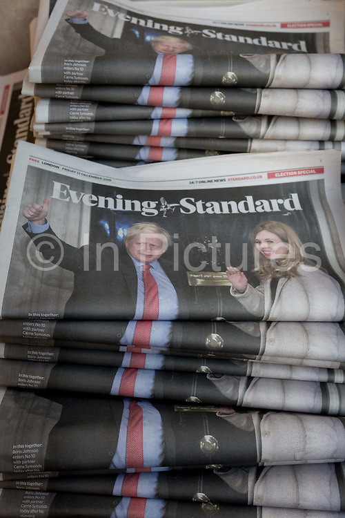 The day after UK Prime Minister Boris Johnsons Conservative Party won a landslide general election victory, winning a majority of 80 parliamentary seats the largest since 1987, the Evening Standard newspaper shows Johnson and his partner Carrie Symonds waving on the steps of 10 Downing Street above the headline Ill Be The Peoples PM, on 13th December 2019, in London, England.