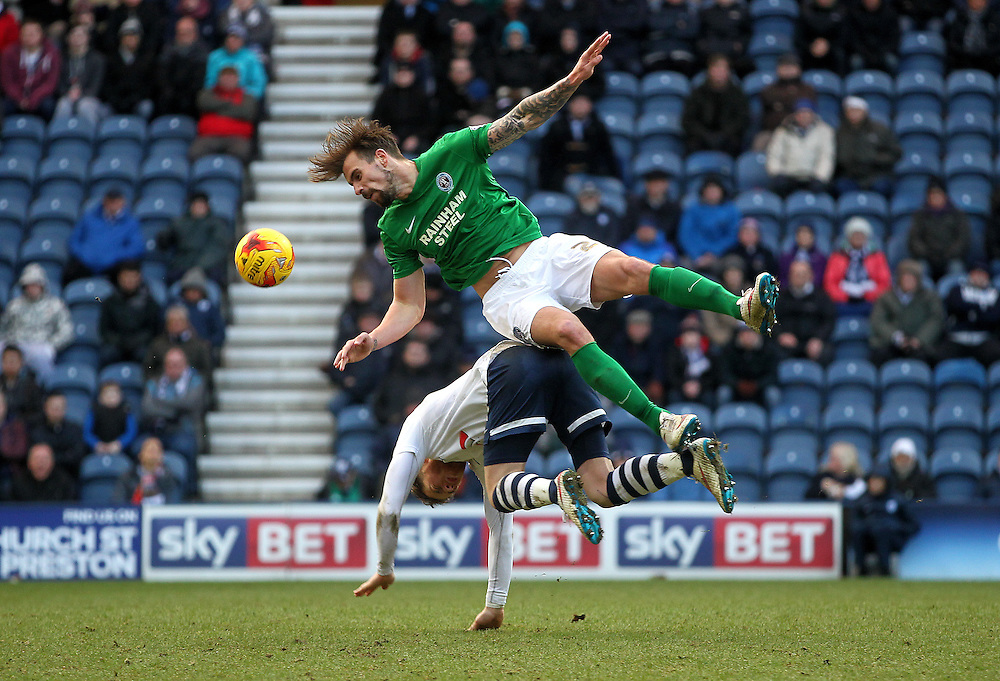 Preston North End's Paul Gallagher clashes with Scunthorpe Utd's Andrew Boyce<br /> <br /> Photographer Mick Walker/CameraSport<br /> <br /> Football - The Football League Sky Bet League One - Preston North End v Scunthorpe United - Saturday 21st February 2015 - Deepdale - Preston<br /> <br /> © CameraSport - 43 Linden Ave. Countesthorpe. Leicester. England. LE8 5PG - Tel: +44 (0) 116 277 4147 - admin@camerasport.com - www.camerasport.com