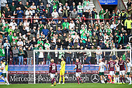 The Hibs fans watch their team during the Cinch SPFL Premiership match between Heart of Midlothian and Hibernian at Tynecastle Park, Edinburgh, Scotland on 12 September 2021.