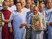 16 DECEMBER 2015 - BANGKOK, THAILAND: Buddhist nuns walk in the funeral procession for Somdet Phra Nyanasamvara, who headed Thailand's order of Buddhist monks for more than two decades and was known as the Supreme Patriarch. He died Oct. 24, 2013, at a hospital in Bangkok and was cremated today. He was 100. He was ordained as a Buddhist monk in 1933 and appointed as the Supreme Patriarch in 1989. He was the spiritual advisor to Bhumibol Adulyadej, the King of Thailand when the King served as a monk in 1956. Tens of thousands of people lined the streets during the procession to pray for the Patriarch.     PHOTO BY JACK KURTZ