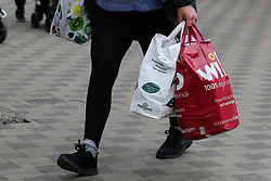 © Licensed to London News Pictures. 21/05/2021. London, UK. A shopper in Wood Green, north London carrying 'bags for life' as the cost of single use plastic carrier bags has increased from 5p to 10p in England. Photo credit: Dinendra Haria/LNP