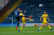 Rochdale midfielder Matthew Lund (21) and AFC Wimbledon midfielder Anthony Hartigan (8)  during the EFL Sky Bet League 1 match between Rochdale and AFC Wimbledon at the Crown Oil Arena, Rochdale, England on 21 November 2020.