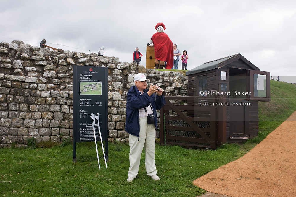Visitors and re-enactment soldier at Housesteads Fort on Roman Hadrian's Wall, once the northern frontier of Rome's empire.
