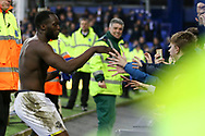 Romelu Lukaku of Everton gives his shirt to a fan at the end of the game. Premier league match, Everton v Hull city at Goodison Park in Liverpool, Merseyside on Saturday 18th March 2017.<br /> pic by Chris Stading, Andrew Orchard sports photography.