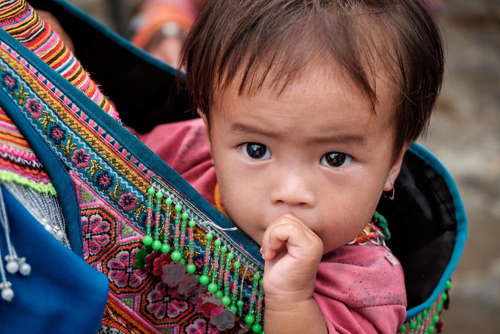 BAC HA, VIETNAM - CIRCA SEPTEMBER 2014:  Vietnamese baby girl at the Bac Ha sunday market, the biggest minority people market in Northern Vietnam