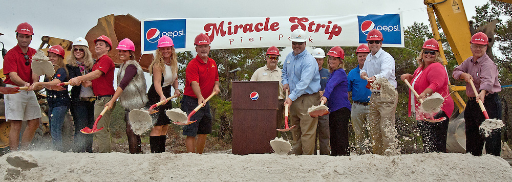 Lance Allison, President & CEO of the Panama City Beach Chamber of Commerce, join Miracle Strip Pier Park owners Teddy & Jenny Meeks and the Panama City Beach Chamber of Commerce Ambassadors