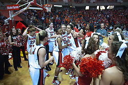 28 March 2010: The Redbirds meet in front of the student section to celebrate the win and sing the ISU Fight Song. The Redbirds of Illinois State squeak past the Illini of Illinois 53-51 in the 4th round of the 2010 Women's National Invitational Tournament (WNIT) on Doug Collins Court inside Redbird Arena at Normal Illinois.