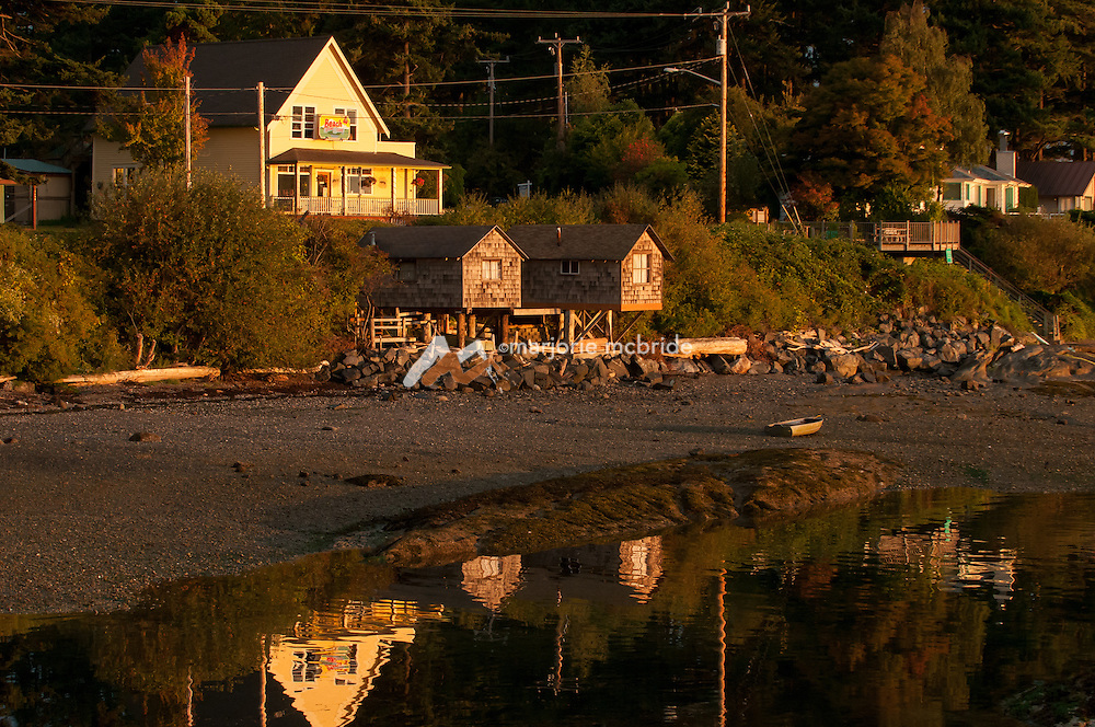 Beach Store Cafe and reflection at sunrise on Lummi Island, San Juan Islands, Washington.