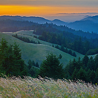 The sun sets over California's Coastal Range, as viewed from the northwestern slopes of Mount Tamalpais in Marin County, California.