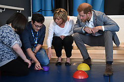 The Duke of Sussex observes a therapy session as he visits the OXSRAD Disability Sports and Leisure Centre, in Oxford.