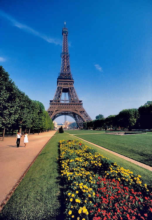 Marigold and calla lilies front the walkway near the Eiffel Tower in Paris, France.