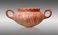 Very early Minoan rounded 2 handled pot with white and red linear motifs,  vaulted tombs Lebena 3000-2100 BC BC, Heraklion Archaeological  Museum, grey background.<br /> <br /> Made of grey clay these pots are the earliest found in the Lebena vaulted tombs .<br /> <br /> If you prefer to buy from our ALAMY PHOTO LIBRARY  Collection visit : https://www.alamy.com/portfolio/paul-williams-funkystock/minoan-art-artefacts.html . Type -   Heraklion   - into the LOWER SEARCH WITHIN GALLERY box. Refine search by adding background colour, place, museum etc<br /> <br /> Visit our MINOAN ART PHOTO COLLECTIONS for more photos to download  as wall art prints https://funkystock.photoshelter.com/gallery-collection/Ancient-Minoans-Art-Artefacts-Antiquities-Historic-Places-Pictures-Images-of/C0000ricT2SU_M9w