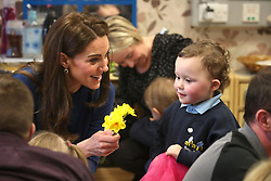 The Duchess of Cambridge speaking to Sofia Sweetlove, aged 3, during a visit to the SureStart Facility in Ballymena as part of a two day visit to Northern Ireland by the Duke and Duchess of Cambridge.