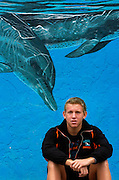 Tampa,FL.--Blair Butler of Plant City High School poses for a portrait near a mural of dolphins.  (Staff/Scott Iskowitz)