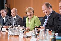 20 JUN 2018, BERLIN/GERMANY:<br /> Niels Annen, SPD, Staatsminister beim Bundesminister des Auswaertigen, Olaf Scholz, SPD, Bundesfinanzminister, Angela Merkel, CDU, Bundeskanzlerin, und Helge Braun, MdB, CDU, Chef des Bundeskanzleramtes, (v.L.n.R.), vor Beginn der Kabinettsitzung, Bundeskanzleramt<br /> IMAGE: 20180620-01-036<br /> KEYWORDS: Kabinett, Sitzung