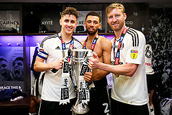 Free to use courtesy of Sky Bet. Tom Cairney, Ryan Fredericks and Tim Ream hold the trophy as Fulham celebrate in the dressing room after winning the game 0-1 to win the Sky Bet Championship Play-Off Final and secure Promotion to the Premier League - Rogan/JMP - 26/05/2018 - FOOTBALL - Wembley Stadium - London, England - Aston Villa v Fulham - Sky Bet Championship Play-Off Final.