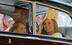 The Duke and Duchess of Cambridge and Prince George leave St George's Chapel at Windsor Castle for the wedding of Meghan Markle and Prince Harry.