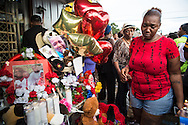 People at a vigil for Alton Sterling at the Triple S Food Mart, Wednesday, July 6, 2016.