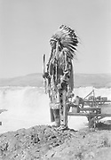 9305-B7367-4. Chief Tommy Thompson at Celilo Falls. August 1940.