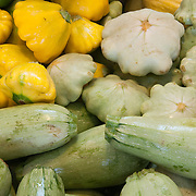 Green and yellow summer squash at a farmstand in Concord, Massachusetts