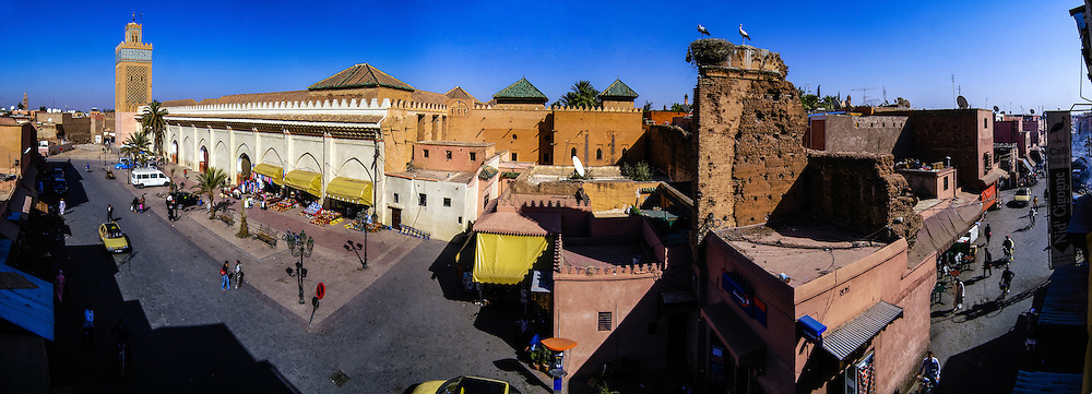 Morocco, Marrakesh. Panorama of Place Yazid and the Kasbah Mosque located in the southern part of the medina in the area known as Kasbah. Two storks are nesting at the right side of the image.