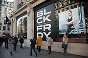 Black Friday signs outside an Asics shop on Regent Street on 29th November 2019 in London, England, United Kingdom. Black Friday is a shopping event that originated from the US where retailers cut prices on the day after the Thanksgiving holiday but is also known as a time for excessive consumerism.