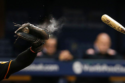 September 29, 2017 - St. Petersburg, Florida, U.S. - WILL VRAGOVIC   |   Times.Chalk explodes off the glove of Baltimore Orioles catcher Welington Castillo (29) during Tampa Bay Rays third baseman Evan Longoria's at bat in the fifth inning of the game between the Baltimore Orioles and the Tampa Bay Rays at Tropicana Field in St. Petersburg, Fla. on Friday, Sept. 29, 2017. (Credit Image: © Will Vragovic/Tampa Bay Times via ZUMA Wire)
