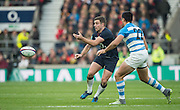 Twickenham, United Kingdom. George FORD, make's a pass,  as Jeronimo DE LA FUENTE, move's in to makes a tackle, during the Old Mutual Wealth Series Rest Match: England vs Argentina, at the RFU Stadium, Twickenham, England, <br /> <br /> Saturday  26/11/2016<br /> <br /> [Mandatory Credit; Peter Spurrier/Intersport-images]