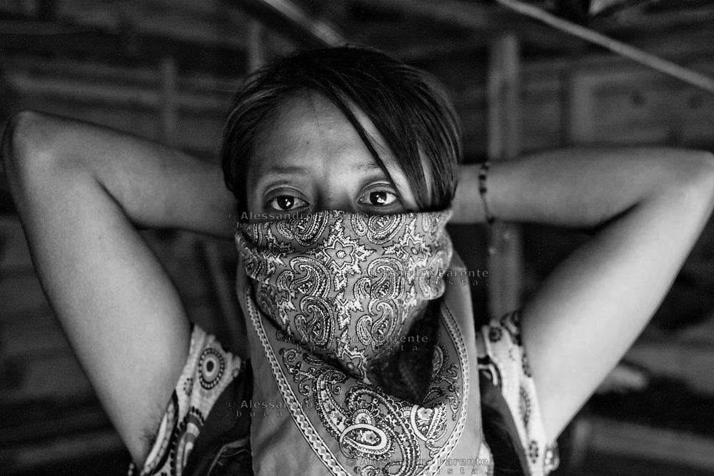 Zapatist woman wearing her shawl.<br /> Mujer zapatista llevando su pañuelo.