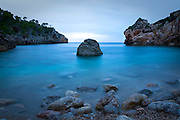 """Evening blues at Cala Deia, Mallorca, Balearic Islands. It was at this rocky inlet that Anais Nin based her erotic short story, """"Mallorca""""."""