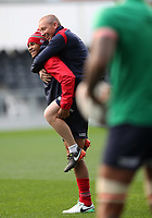 Rugby Union - 2017 British & Irish Lions Tour of New Zealand - Captains Run - <br /> <br /> Jonathan Joseph of The British and Irish Lions gives a lift to Paul Stridden the Lions strength and conditioning coach during the Captains run at Forsyth Barr Stadium, Dunedin.<br /> <br /> COLORSPORT/LYNNE CAMERON