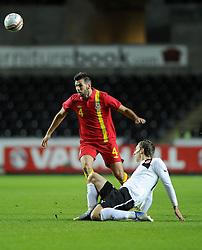 Joe Ledley (Celtic) of Wales battles for the ball with Florin Klein (Red Bull Salzburg) of Austria  - Photo mandatory by-line: Joe Meredith/JMP - Tel: Mobile: 07966 386802 06/02/2013 - SPORT - FOOTBALL - Liberty Stadium - Swansea  -  Wales V Austria - International Friendly