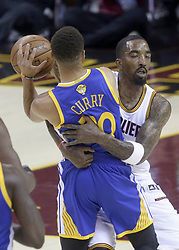 June 7, 2017 - Cleveland, OH, USA - The Cleveland Cavaliers' J.R. Smith grabs hold of the Golden State Warriors' Stephen Curry during a first-quarter fast break in Game 3 of the NBA Finals on Wednesday, June 7, 2017, at Quicken Loans Arena in Cleveland. (Credit Image: © Phil Masturzo/TNS via ZUMA Wire)