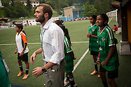 Yuwa team coach Franz Gastler and players  at the benches watching the game against Añorga team. Donostia-San Sebastian (Basque Country)  02 July 2013. Yuwa Jharkhand is a program for girls aged 5-17 to promote health, education and improved livelihoods through football. Yuwa team was in Donostia playing Donosti Cup international football tournament (Gari Garaialde/Bostok Photo)