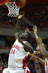 12 February 2011: Tony Lewis grabs a rebound from under the hoop during an NCAA Missouri Valley Conference basketball game between the Missouri State Bears and the Illinois State Redbirds at Redbird Arena in Normal Illinois.