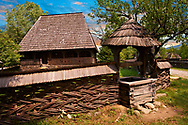 """19th century Wooden House & well  """" Ilea Calinesti"""" from the Valley of Cosaului, The Village museum near Sighlet, Maramures, Northern Transylvania .<br /> <br /> Visit our ROMANIA HISTORIC PLACXES PHOTO COLLECTIONS for more photos to download or buy as wall art prints https://funkystock.photoshelter.com/gallery-collection/Pictures-Images-of-Romania-Photos-of-Romanian-Historic-Landmark-Sites/C00001TITiQwAdS8"""